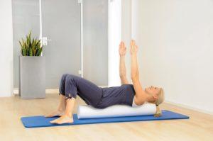 Übungen Pilates-Rolle